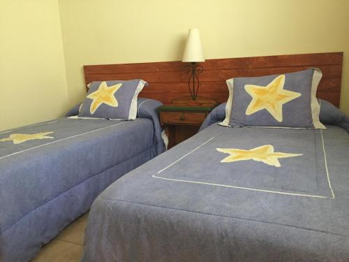 A bed or beds in a room at Casa Paraiso