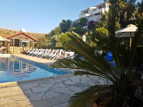 The swimming pool at or near Ampelokipi Holiday Apartments
