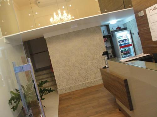 The lobby or reception area at Colatina Plaza Hotel
