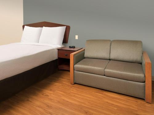A seating area at WoodSpring Suites Topeka