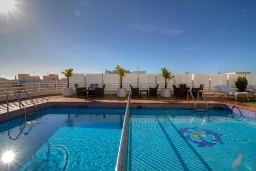 The swimming pool at or near Hotel Royal Plaza