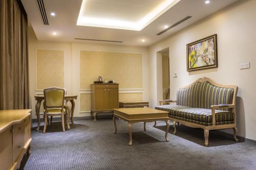 A seating area at La Roche Hotel