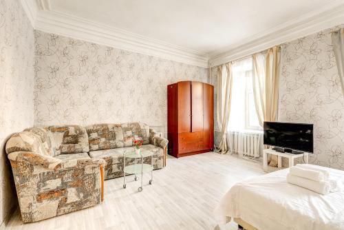 Гостиная зона в Apartments 4-aya Tverskaya-Yamskaya, 4