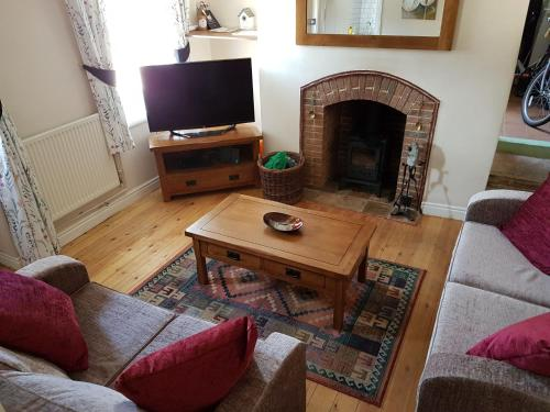 A television and/or entertainment center at Flint Cottage