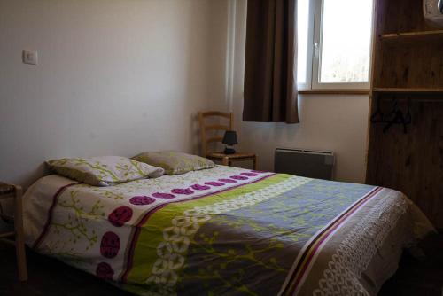 Un ou plusieurs lits dans un hébergement de l'établissement Gite De La Distillerie