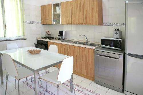 A kitchen or kitchenette at Positano Holidays