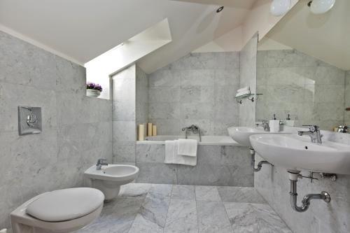 A bathroom at Royal Prague City Apartments