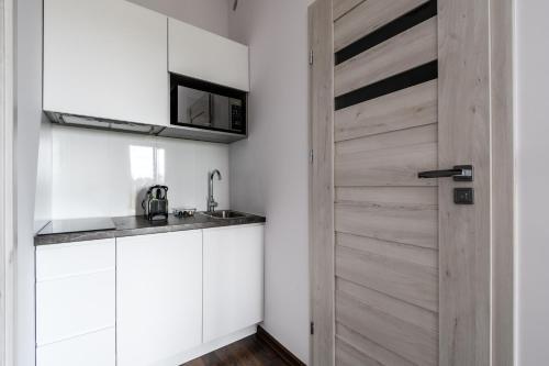 Kuchnia lub aneks kuchenny w obiekcie Park Avenue Apartments
