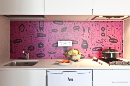 A kitchen or kitchenette at Ryans Ibiza Apartments - Only Adults