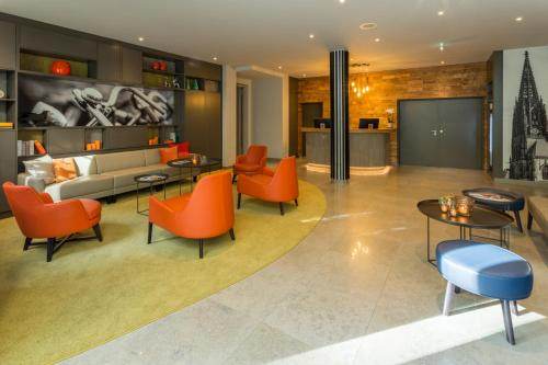 The lobby or reception area at Parkhotel Hohenfeld Münster