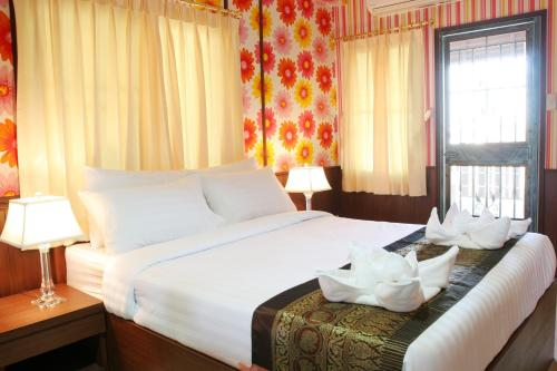 A bed or beds in a room at Orchid Resort