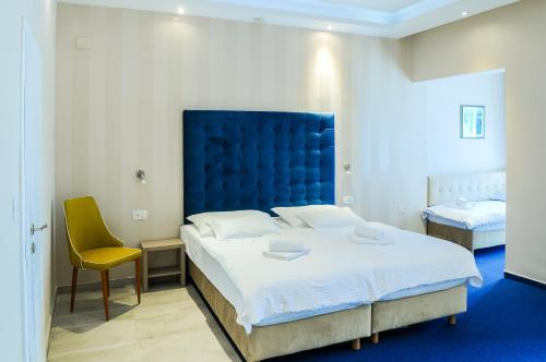 A bed or beds in a room at Beach Hotel Bozikovina