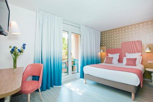 Ein Bett oder Betten in einem Zimmer der Unterkunft Residhome Nice Promenade