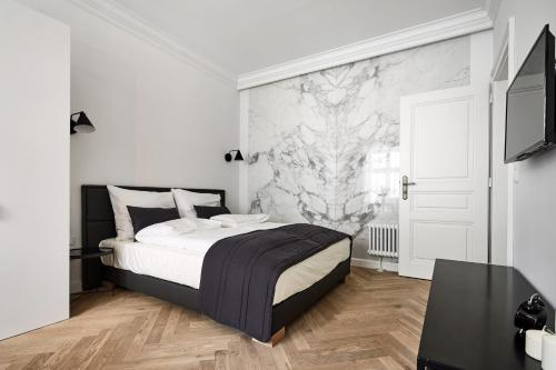 A bed or beds in a room at 1891 Aparthotel