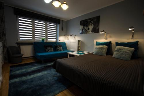 Łóżko lub łóżka w pokoju w obiekcie U Huberta