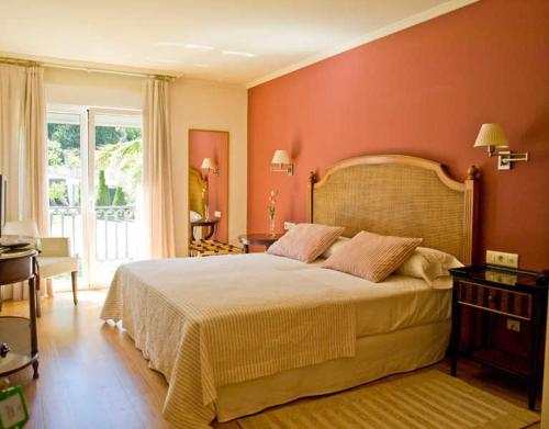 Cama o camas de una habitación en Hotel Mabel