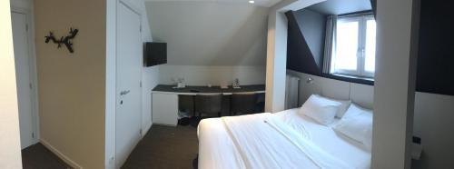 Un ou plusieurs lits dans un hébergement de l'établissement Hotel Astel
