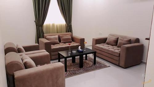 Uma área de estar em أجنحة الرؤية للوحدات السكنية قصر النهضة سابقاً