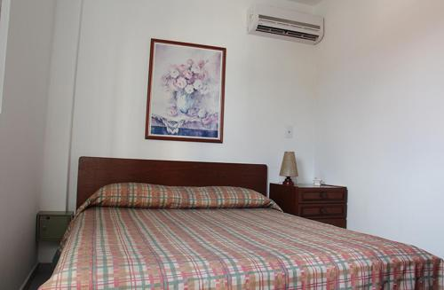 A bed or beds in a room at Residencial Maria Da Praia
