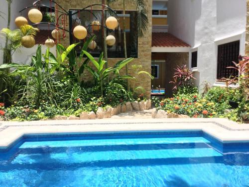 Het zwembad bij of vlak bij Hotel Las Golondrinas