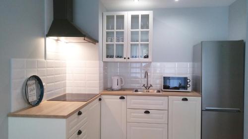A kitchen or kitchenette at Apartament Ku Morzu II Ustronie Morskie