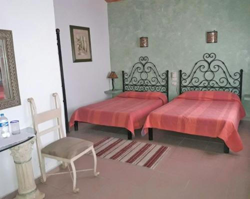 A bed or beds in a room at Quinta Aremar