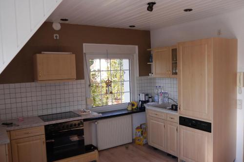A kitchen or kitchenette at Ferienwohnung-Kuechler