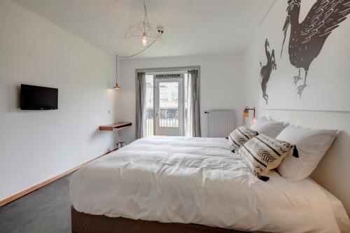 Кровать или кровати в номере Bed and Breakfast Zuid Oost Heesterveld / BnB ZOH