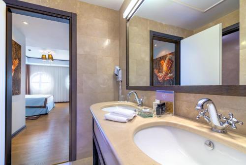 חדר רחצה ב-Epoque Hotel - Relais & Chateaux