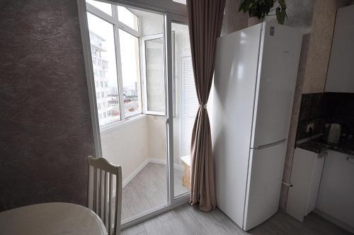Телевизор и/или развлекательный центр в Business Apartment Griboyedova 31