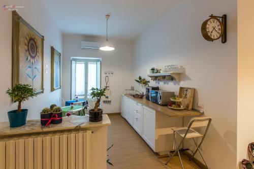 Cucina o angolo cottura di B&B A Casa dei Nonni