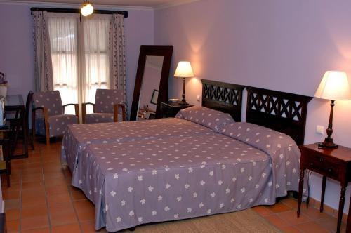 Cama o camas de una habitación en Posada Real del Pinar