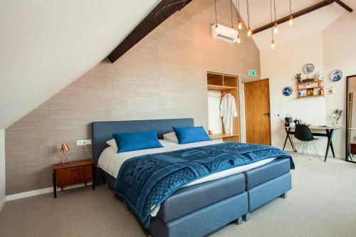 Un ou plusieurs lits dans un hébergement de l'établissement La Paulowna Boutique Hotel