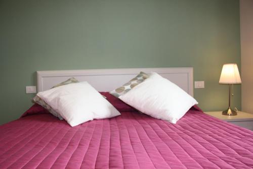 Letto o letti in una camera di Appartamenti Emilio