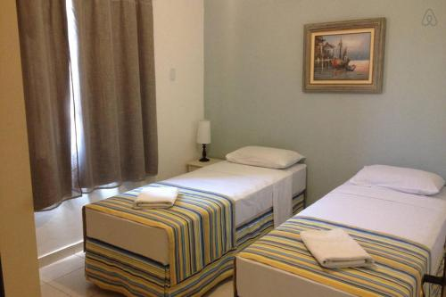 A bed or beds in a room at Chale Buzios Praia Rasa