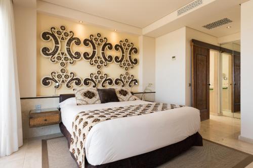 Un ou plusieurs lits dans un hébergement de l'établissement Alondra Villas y Suites