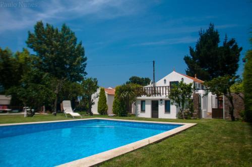 The swimming pool at or near Casa Da Noquinhas