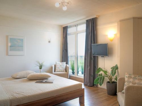Un ou plusieurs lits dans un hébergement de l'établissement Hotel Nehalennia