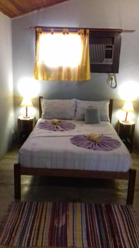 A bed or beds in a room at Maracujá Hostel