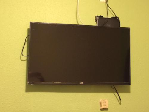 A television and/or entertainment center at Roxy Hotel