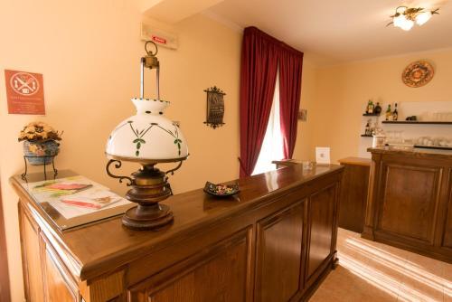 The lobby or reception area at Albergo Della Corte