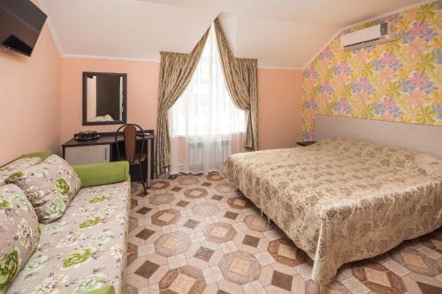 Кровать или кровати в номере Отель Кипарис