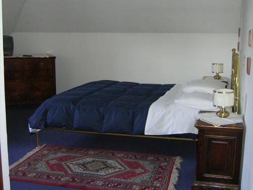 A bed or beds in a room at Albergo San Cristoforo