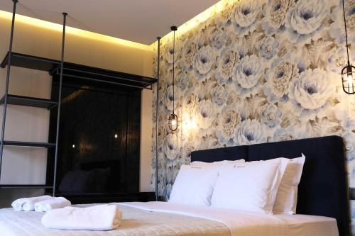 A bed or beds in a room at 4 Seasons Luxury Apartments