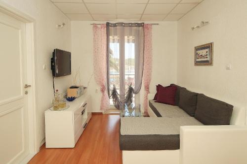A seating area at Apartment Adriatica City
