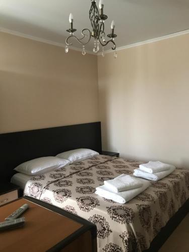 Кровать или кровати в номере Guest House Stariy Dvorik