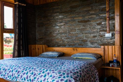 A bed or beds in a room at Panchachuli House