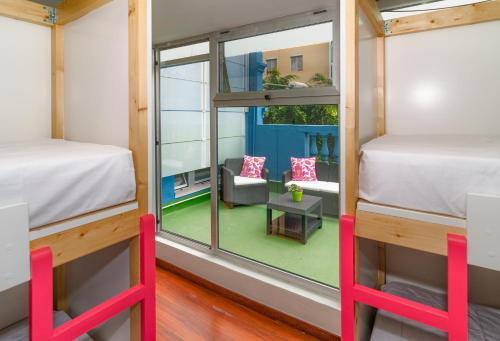 A bunk bed or bunk beds in a room at La Fabrica Urban Hostel Las Palmas