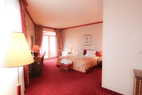 A bed or beds in a room at PLAZA Schwerin; Sure Hotel Collection by Best Western