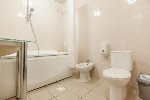 Ванная комната в Отель Регина Малые Клыки